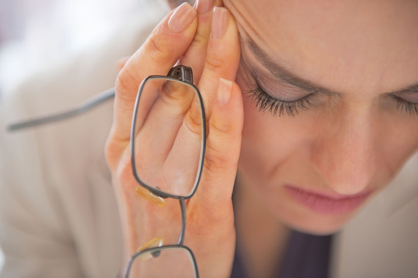 girl clutching face and glasses mental health is limiting working women