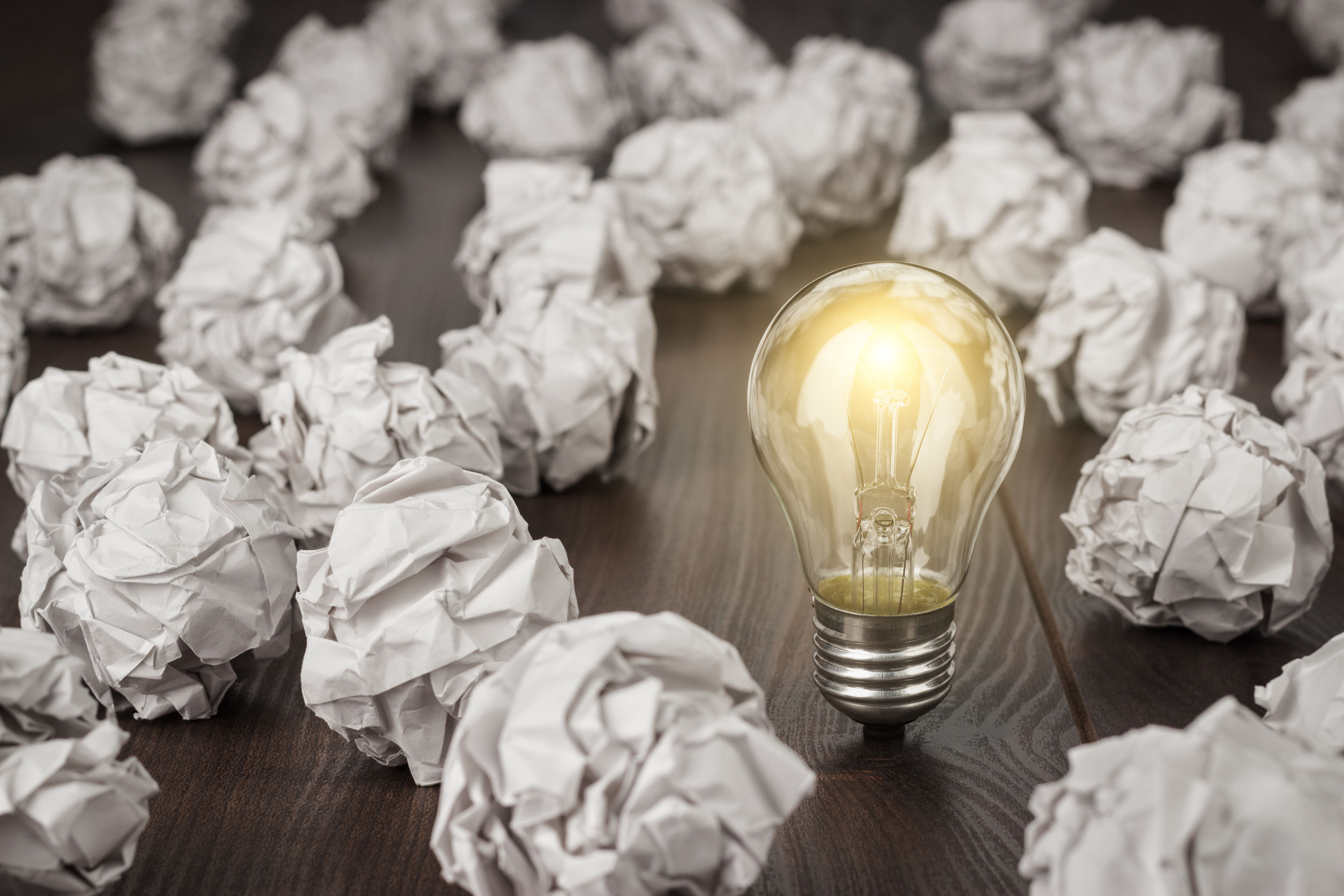 ligthed lightbulb crumpled paper in wooden desk growth mindset interventions are not effective