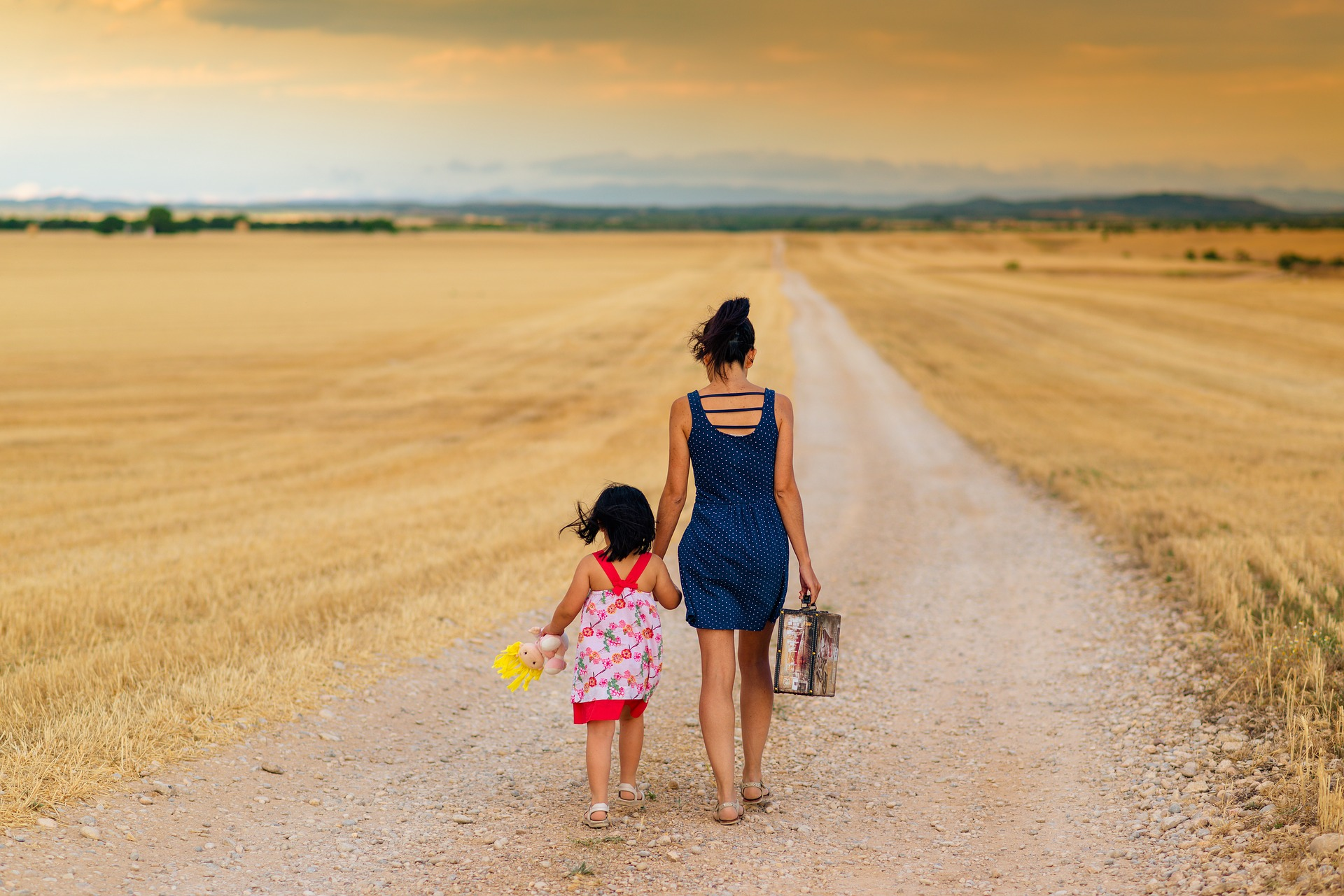 mother and child walking on a road parent shaming degrade mothers health